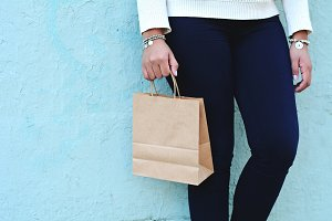 Female hands holding shopping bag ou