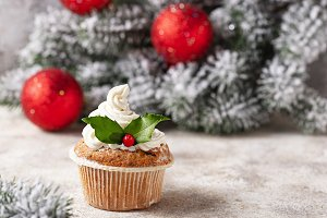 Christmas festive cupcake with holly