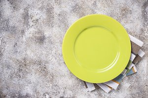 Empty plate on concrete table
