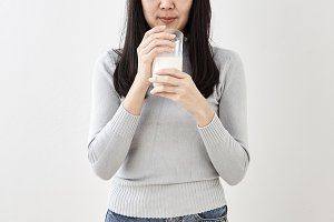 Woman Drinking Glass Of Fresh Milk