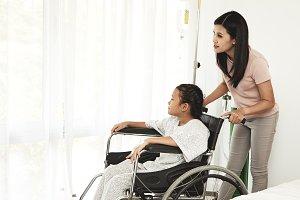 female child patient in wheelchair