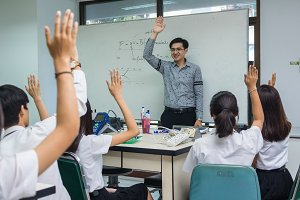 Asian teacher Giving Lesson over the
