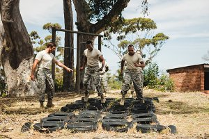 Trainer giving training to soldiers
