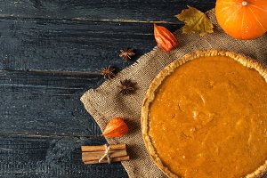 Pumpkin pie on a wooden table