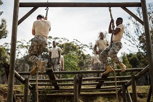 Soldiers training rope climbing