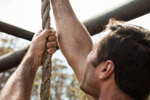 Soldier training rope climbing