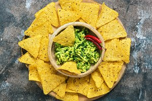 Bowl with guacamole with nachos on a