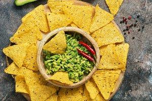 Homemade guacamole with nachos on a