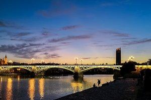 Triana Bridge in Seville at dusk.