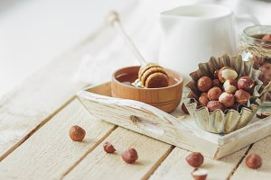 Honey in the wooden bowl, hazelnuts