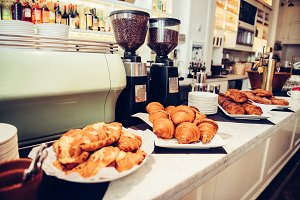 Coffee machine and fresh croissants