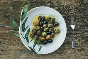 Olives with a branch of olive tree