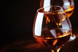 Grape brandy in shot glass, dark bro