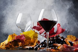 Dry red wine in large glass, autumn