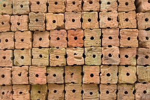 group of red bricks on construction