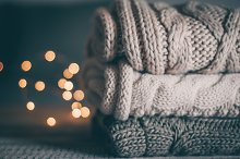 Stack of cozy knitted sweaters by  in Holidays