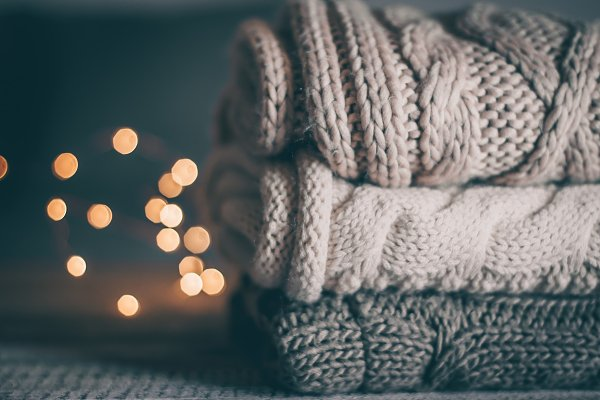 Holiday Stock Photos - Stack of cozy knitted sweaters