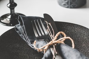 Festive table setting in a black