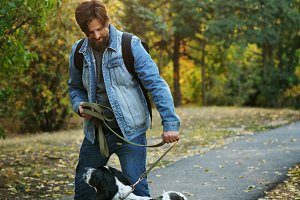 Man and dog in autumn park