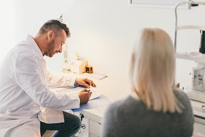 Doctor filling medical questionnaire