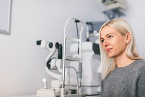 Woman sitting at the optician's offi