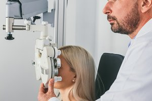 Doctor examining his patient's sight