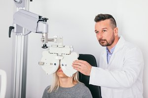 Optician testing his patient's eyes.