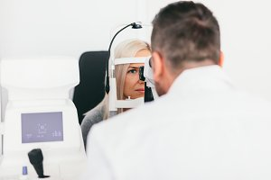 Doctor checking his patient's eyesig