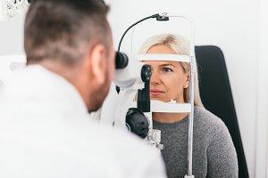 Woman undergoing eyesight exam in op