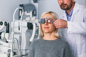Optician checking patient's eyesight