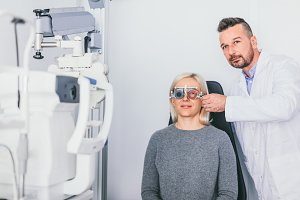 Doctor checking patient's eyesight