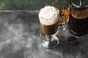 Irish coffee with whisky on dark bac