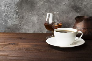 Coffee in white cup with cognac and