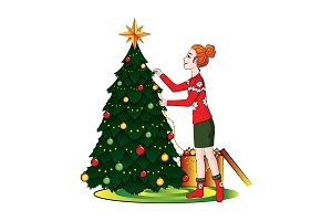 A girl decorates a Christmas tree