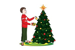 boy (man) decorates  Christmas tree