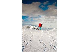 Man climbs on a snow slope