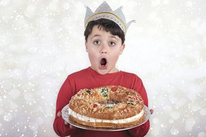 surprised child with King cake