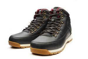 Dark black boots with shoelace on
