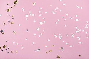 Golden stars glitter on trendy pink