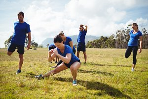 Fit people exercising in boot camp