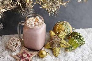 Glass winter cup of hot chocolate
