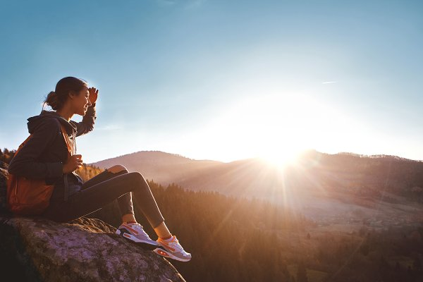 People Stock Photos: vitaliymateha photography - woman sits on edge of cliff against