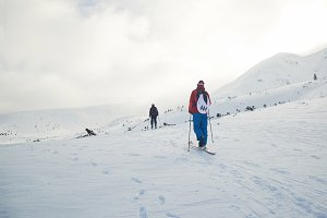 Ski touring couple hiking up a