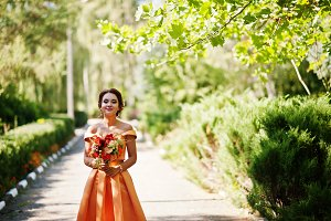 Attractive bridesmaid in orange dres