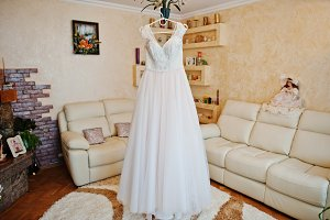 Lovely white wedding dress hanging o