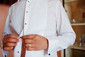 Portrait of an attractive groom dres