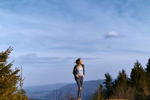 woman hiker standing on mountain