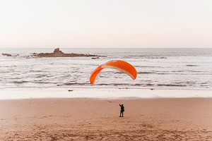 Paragliding on the beach in the legz