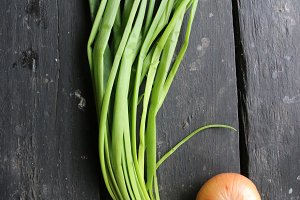 Green onions lying on an old vintage