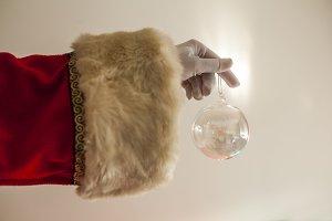santa claus arm holding a christmas